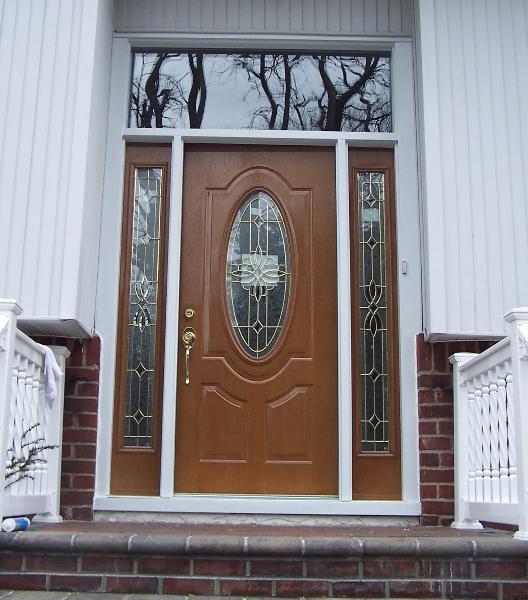 Decortive moldings entrance doors catheadral top doors for Insulated storm doors